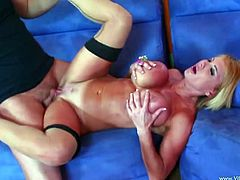 Light-haired sexploitress wearing black stockings gives a head to the buddy. Then she gets her slit drilled in a sideways pose and doggystyle until fucker sprays her silicone boobs with hot sperm.