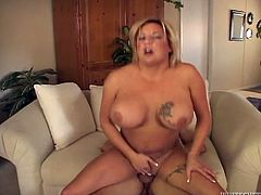 Amazing tattooed blond haired MILF with bog boobs and sexy ass gets her wet cunt fucked hard riding a cock in cowgirl pose. Have a look at this babe in Fame Digital sex clip.