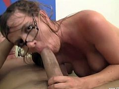A naughty blonde chick in glasses takes off her clothes. This busty whore sucks a dick and licks balls. Then Anita Blue gets her wet pussy fucked in a rough manner.