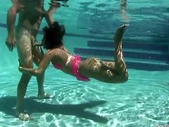 A slim brunette girl in a bikini plays with her pussy and sucks a dick outdoors. Then Miss Raquel gets fucked in a pool under water.