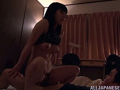 There are two Asian girls in a room. One of them is sleeping. The other one has sex with her man. She gets fucked in a reverse cowgirl and a missionary poses.