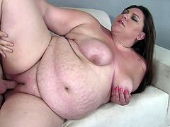 Salacious BBW Bella Bendz has finally found a man who doesn't mind to fuck her. She gives a blowjob to the dude and fucks him in the cowgirl position. Her natural tits and big belly bounce like jelly.