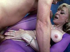Mature bitch in sexy outfit is ready to give a hot massage to a guy and his lucky dick. She blows him off and is then fucked doggystyle.
