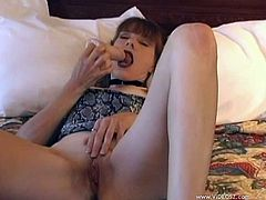 Kinky brown-haired mom is playing dirty games in her room. She fingers her shaved pussy ardently, then rubs and fucks it with her realistic dildo.