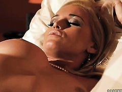 Blonde Kathia Nobili gives a closeup of her wet spot while masturbating with toy