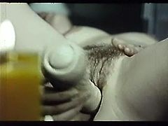 Curly and black haired bitch with tiny titties lies on floor and moans in delight banging her sweet cunt with sex toy. Have a look at that steamy solo in The Classic Porn sex clip!