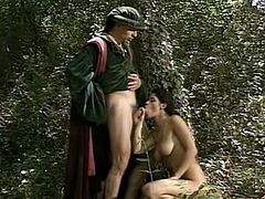 Kinky stud trailed his busty black haired maid in the garden and forced her to suck his throbbing lollicock ardently. Then rewarded her pussy with solid doggy pose fuck. Watch that steamy fuck in The Classic Porn sex clip!