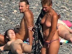 Horny voyeur must feel amazing watching such beauties exposing their nude forms at the beach