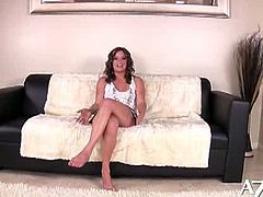 Sex hungry brunette Bella Rossi lays on the sofa in sultry outfit while taking off her clothes she rubs her round tight tits and finger fucking shaved wet pussy.Enjoy!