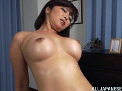 Sexy Asian MILF with big natural rides a hard cock and gets her sweet hairy pussy fucked hard doggystyle while she rubs her clit.
