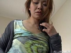 Kinky Japanese milf lets a guy eat her pussy in the bedroom. After that they fuck in the missionary position and the slut moans sweetly with pleasure.