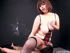 Chubby big-breasted Japanese milf, Marie Momoka, wearing stockings and fishnets, gives a blowjob to a horny man. After that they fuck in the cowgirl position and doggy style.