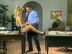 Feverish policeman eats smelly kitty of his light haired wanton hottie on table