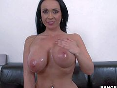 Sandra is a hot bodied european milf next door. She takes off her jeans and poses in her sexy underwear. She pulls out her massive melosna and then exposes her killer butt with her panties on and flashes her pussy.