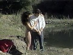 Hot dark haired hooker with small tits seized big penis of her man and got to suck it hard.Look at that steamy BJ in The Classic Porn sex clip!