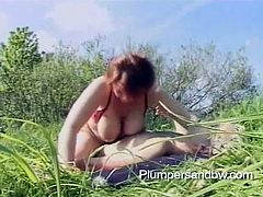 This sexy mature lady with huge boobs takes a walk to the park so she can get her mouth around a big dick and her hot pussy rammed hard.