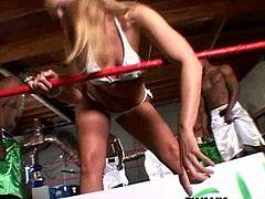 This ring girl goes the extra mile when she let's these two black studs fuck her hard then they double penetrated her in the middle of the ring.