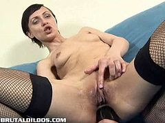 Amber is a horny Russian brunette and she is ready for some amazing anal action. She is wearing her favorite fishnets and sticks big dildo up her tight asshole.