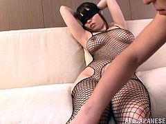 Big-breasted Japanese skank, wearing fishnet bodystocking, lets a man knead her massive narural jugs. Then she moves her legs wide apart and gets her coochie rubbed with a dildo.