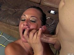 Fake tittied brunette Tory blows big cock standing on her knees. She gives good yum-yum blowjob and her eyes are closed with pleasure.