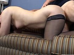 This incredibly perverted whore in sexy black stockings needs a good pussy workout and this dude is here to pound her tight snatch. Horny dude bends her over the couch and fucks her mercilessly in and out loosening her once tight hole. Then he fucks her pussy in missionary position.