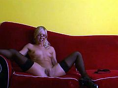 Admirable light-haired enchantress wearing black nylon stockings strips on cam exposing her hot boobs and smooth ass. Then she spreads her legs and toys her trench.