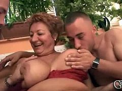 Garanny brings you a hell of a free porn video where you can see how a busty redhead Granny enjoys two young cocks while assuming some very hot poses til she cums.