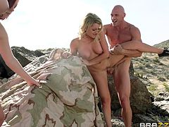 Busty hotties Brooke Wylde, Chloe Addison and Mary Jane Mayhem are having fun with Johnny Sins outdoors. The bitches suck and rub the dude's cock by turns and welcome it in their pussies.