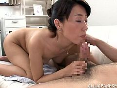 Japanese milf Mako Morishita shows her cunt to a man and lets him finger it. After that she sits down on the man's wang and they bang in the cowgirl position.