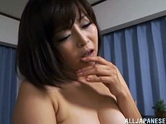 Big-breasted Japanese milf shows her tits to a guy and makes him horny. Then she stands on all fours and welcomes his wang in her throbbing pussy.