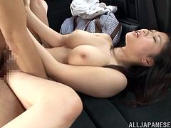 Get a load of Ruri Saijo's beautiful and large breasts in this hardcore scene where this busty Japanese babe is fucked in the backseat of a car.