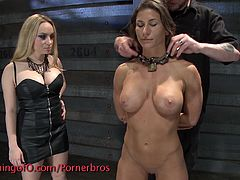 Check out this horny brunette tied up in the dungeon and forced to suck pussy. She moans loud, when she got her snatch toyed hard!