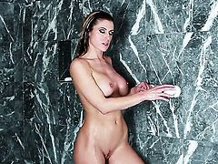 Randy Moore with gigantic tits and shaved bush has some time to rub her honeypot