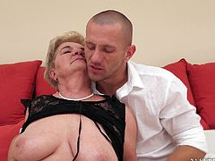 Get a boner watching this blonde granny, with natural boobs and a shaved pussy, while she gets her pussy licked before getting fucked.
