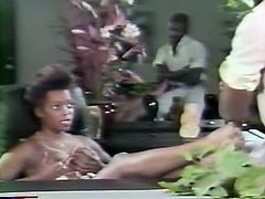 Curly haired black bitch with big titties got her wet chocolate pussy attacked in mish and doggy positions by staff cock of her lover. Enjoy that hard fuck in The Classic Porn sex video!
