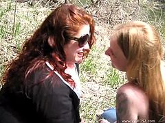 Chubby redhead seductress takes off her clothes exposing her big natural boobs. Thereafter skinny blonde skank undresses too to demonstrate her juicy tits.