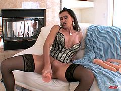 Have a blast watching this brunette cougar, with big gazongas wearing nylon stockings, while she touches herself and plays with giant toys.