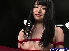 cute young asian babe tied