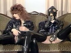 Any lover of classic porn videos needs to check out this crazy lesbian scene. Spoiled chicks in latex clothes get together to fuck their tight pussies with their sex toys.