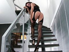 Prepare your cock for this brunette babe, with a nice ass wearing sexy stockings, while she touches herself on the stairs and plays with you.