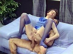 Lusty brunette in purple stockings gtes her hairy pussy fucked hard missionary style from behind. She is horny and adorable. Just enjoy watching her for free.