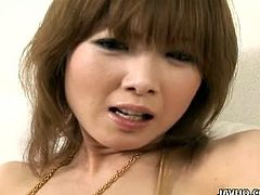 Rika Sakurai fingers and toys her cunt. She oils up her pussy using her pussy juices and she masturbates with total self-pleasure. She rubs her pink pussy lips and gets her pussy super wet.