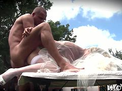 This sexually charged bride needs a good pussy workout right here and right now and her horny fiance is here to fuck her tight twat. He bends her over the table and fucks her really hard. Then she rides his swollen dick in cowgirl position.