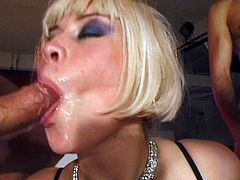 Get a boner by watching this blonde cougar, with gigantic jugs wearing nylon stockings, while she goes extremely hardcore with horny men.