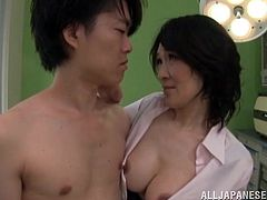 A very sexy Asian nurse with big tits and a great body enjoys playing with a patient's big cock. Hear him moan with pleasure now!