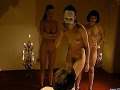 Tiffany Hopkins, Laura Angel, Melanie Coste, Annie Lam and Kissima are having lesbian BDSM fun indoors. One of the sluts lets the others beat her back and ass and gets her cunt smashed with a strapon.