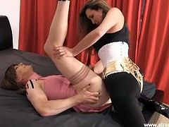 Checkout this busty Milf Jane. Today strapon Jane throws this horny TGirl slut on her bed and after watching this naughty tranny masturbate, she fucks her in the ass hard. Enjoy!