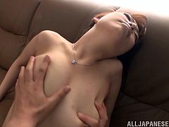 Make sure you check out Miyuki Matsushita's amazing body in this hot scene where this Japanese babe is masturbated with a vibrator on a couch.