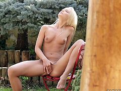 Go wild as you watch this blonde hottie, with small boobs wearing panties, while she touches herself outdoors in a really erotic way.