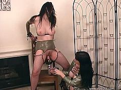 Gorgeous Anastasia Pierce and Paige Richards enjoy some bondage lesbian fun as they drill their pussies with a big vibrator machine.